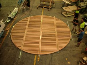Large motorised round timber louvres
